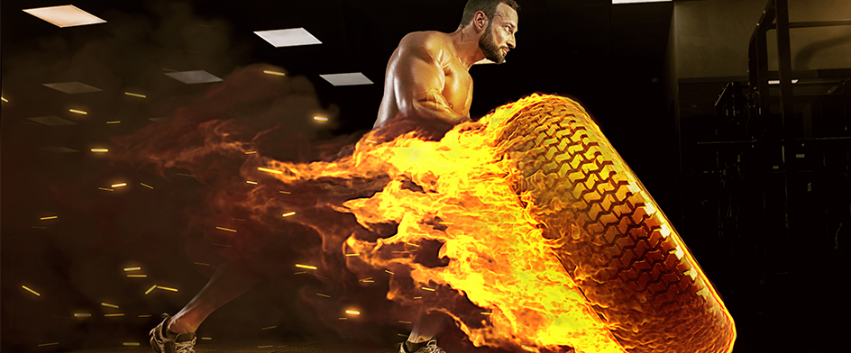 Mann am brennenden Reifen
